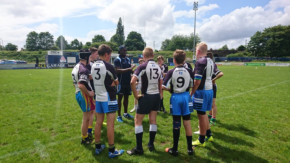 Coach Jamahl Hunte with Coventry Bears Juniors at half time