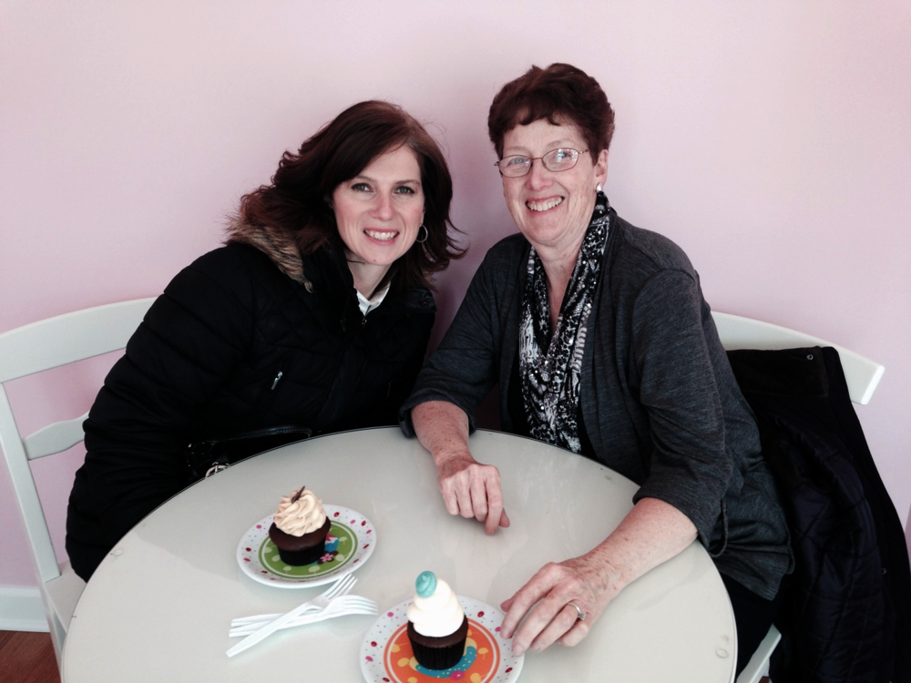 Near the end of our shopping trip, we stopped in for cupcakes at  The Latest Crave . That's my mom and sister enjoying our chocolate peanut butter and chocolate  selections -- delicious!
