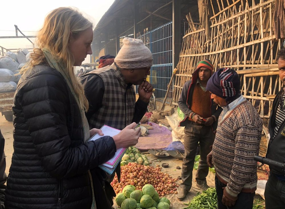 Interviewing vegetable traders at the market in Pharenda