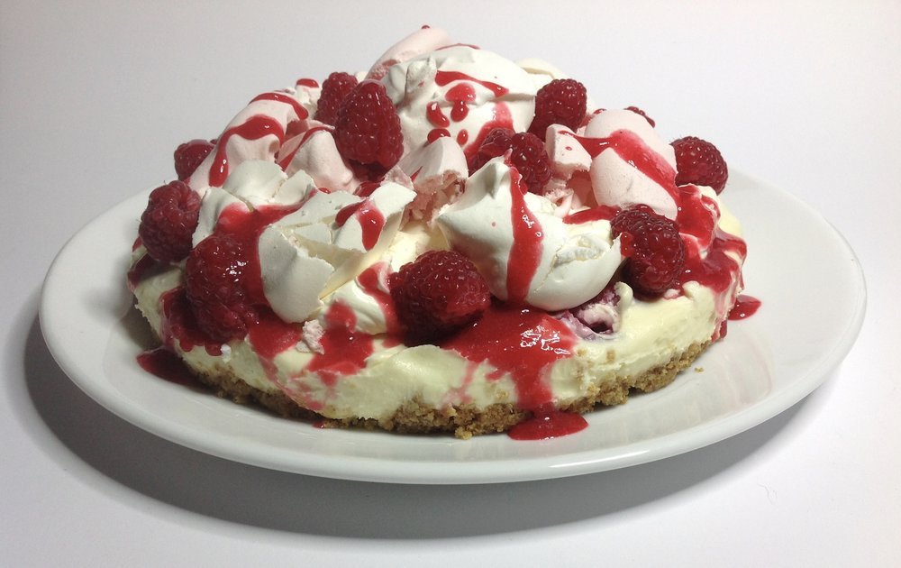 'Eton Mess Cheesecake'  White Chocolate Cheesecake, White & Rose Meringues, Raspberries, Raspberry Coulis & Cream