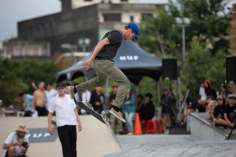 Brad Cromer performing a kickflip