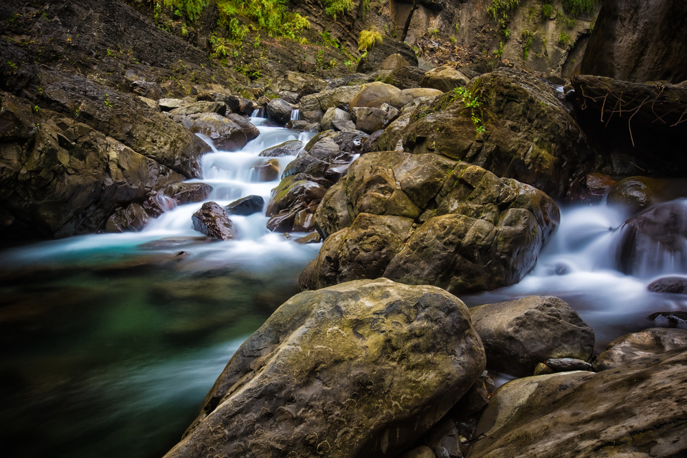 - Long exposure of the river at the base of Xiaowulai Waterfall.