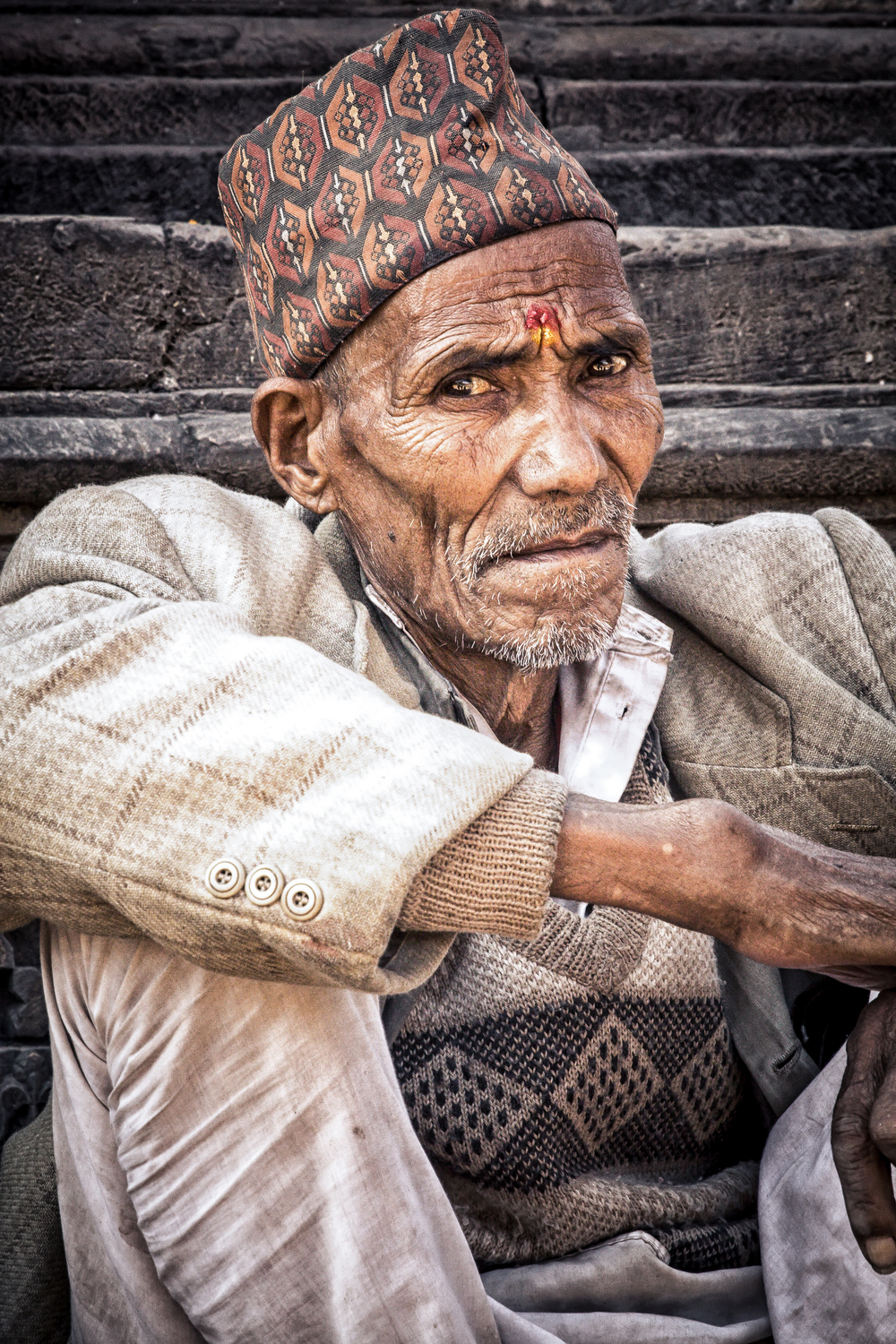 - A Nepali man taking an afternoon break in Patan Square just outside of Kathmandu, Nepal.