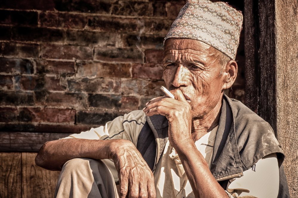 - A Nepali potter taking a cigarette break on a hot day in Bhaktapur, Nepal