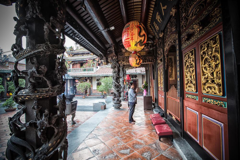 - A Taiwanese woman praying at Bao-An Temple (保安宮)