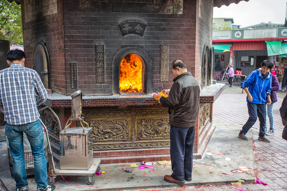 A Taiwanese man burning Ghost Money