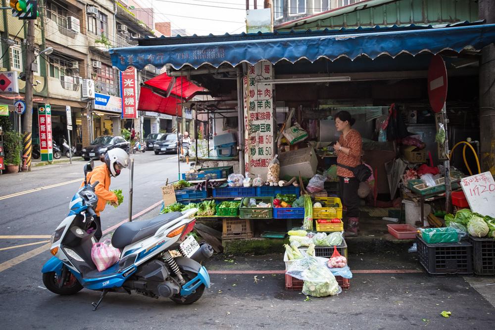 A local farmer selling produce on a street near Daxi Old Street