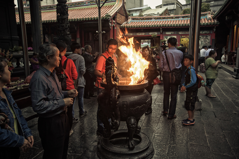 Crowding around the incense urn