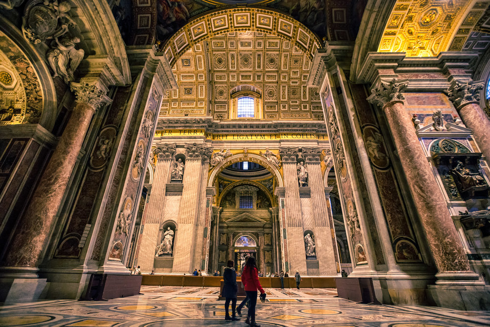 Tourists walking through the corridors of St. Peter's Basilica