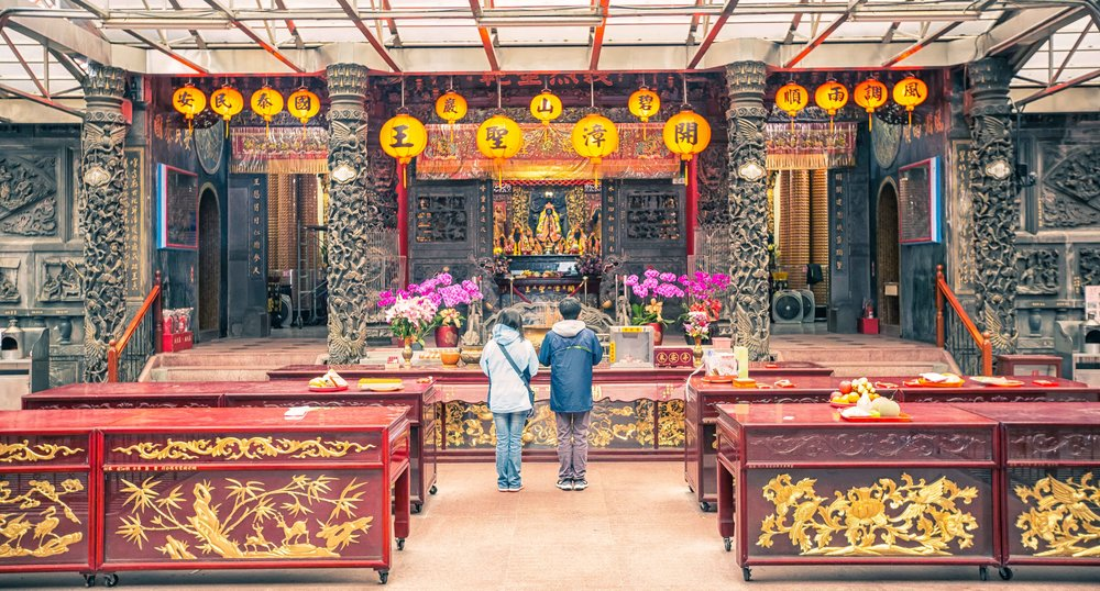 Praying outside of the main shrine