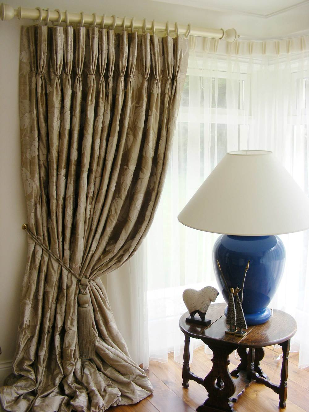 Luxurious Silk Curtain with french pleats hung from ornate pole