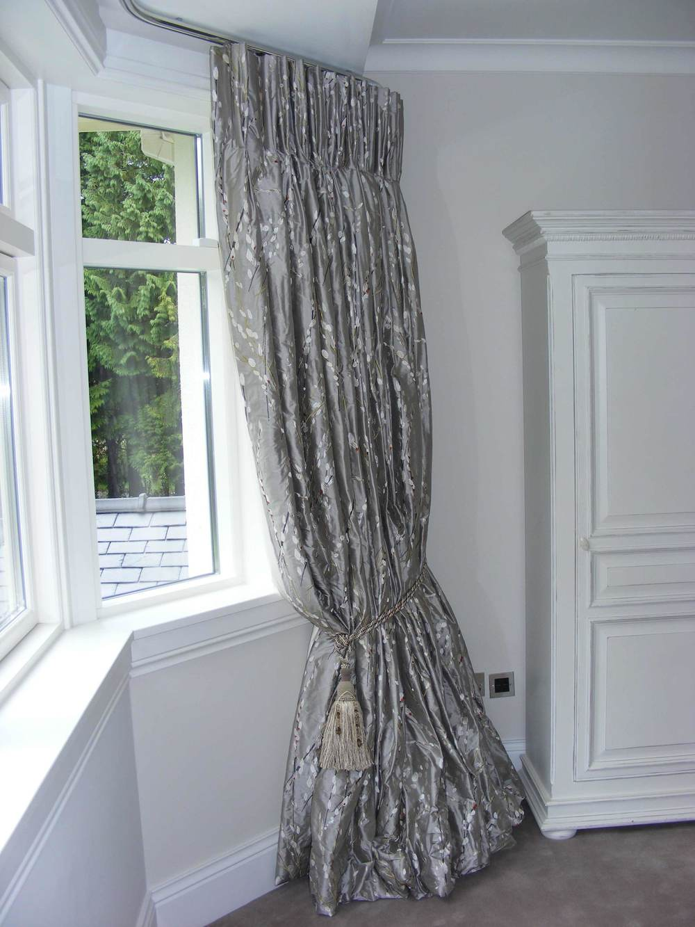French pleated curtain hung from   made to measure metal rail