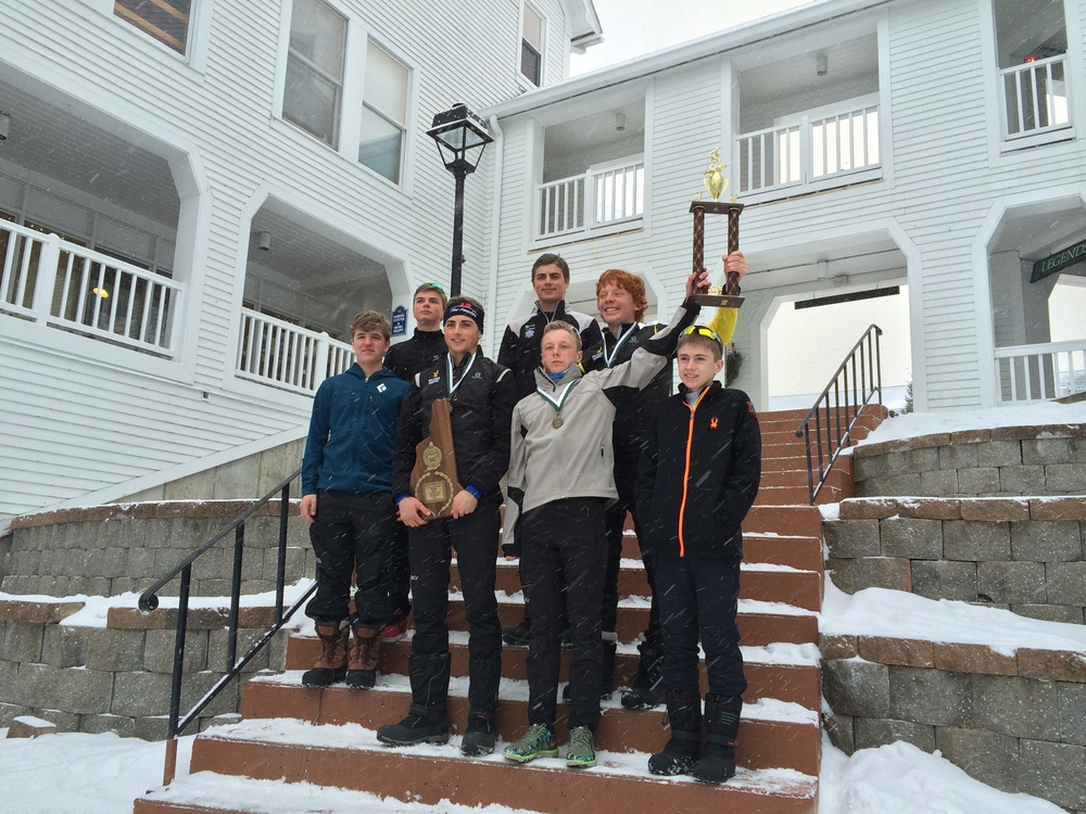 Gilford Boys Team hold their Sibley Trophy high as winners of the 2016 Coaches Series Race at Bretton Woods, NH with a total score of 51 points.