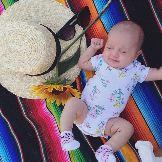 O N E  M O N T H :: We made it! Little Mikayla loves to give us little smiles, she's holding her head up and she's super strong! She likes to kick and wave her hands in the air. She snorts when she sleeps. She recognizes mom and dad's voice and her most favourite thing to do is EAT. ❤️🌻