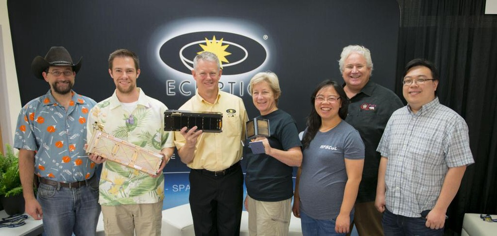 Members of the LightSail Team gather to celebrate the 2015 AIAA Award for Small Satellites - Mission of the Year in Logan, Utah