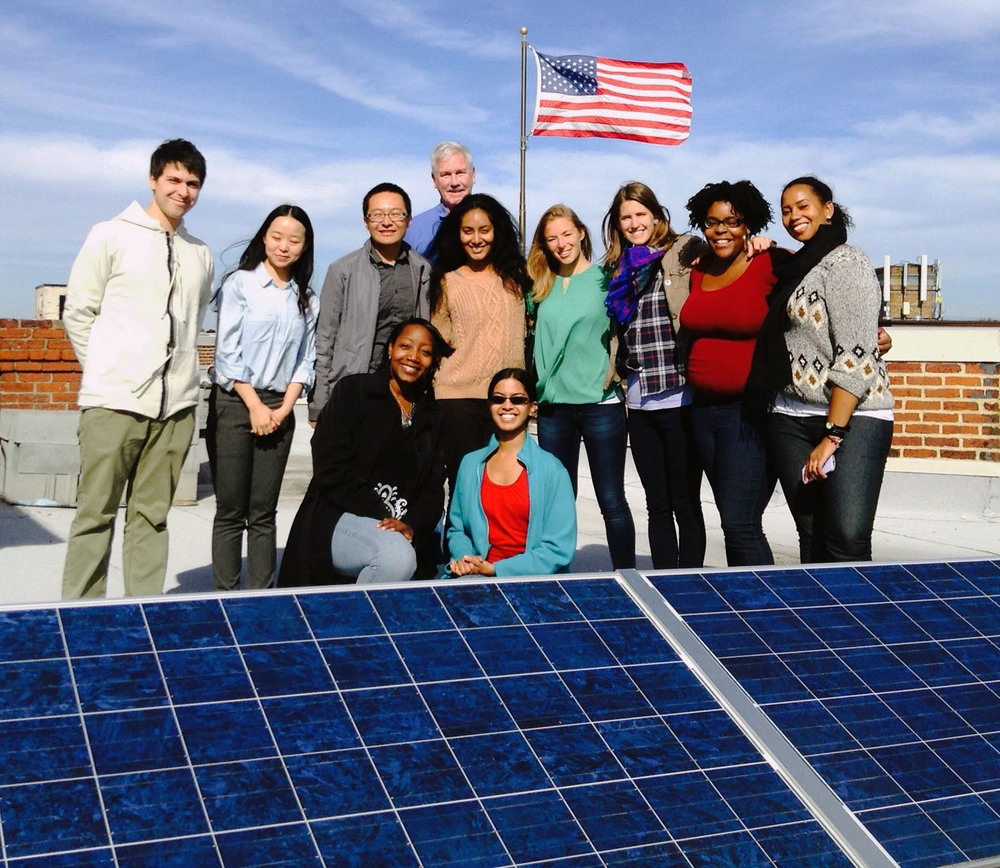 johns Hopkins graduate students take a rooftop solar tour of an apartment building in Mount pleasant. photos courtesy of grant Klein/DC Sun.