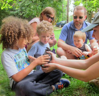 kids interact with bunnies, ducklings, and baby goats from leesburg animal park's traveling baby zoo.