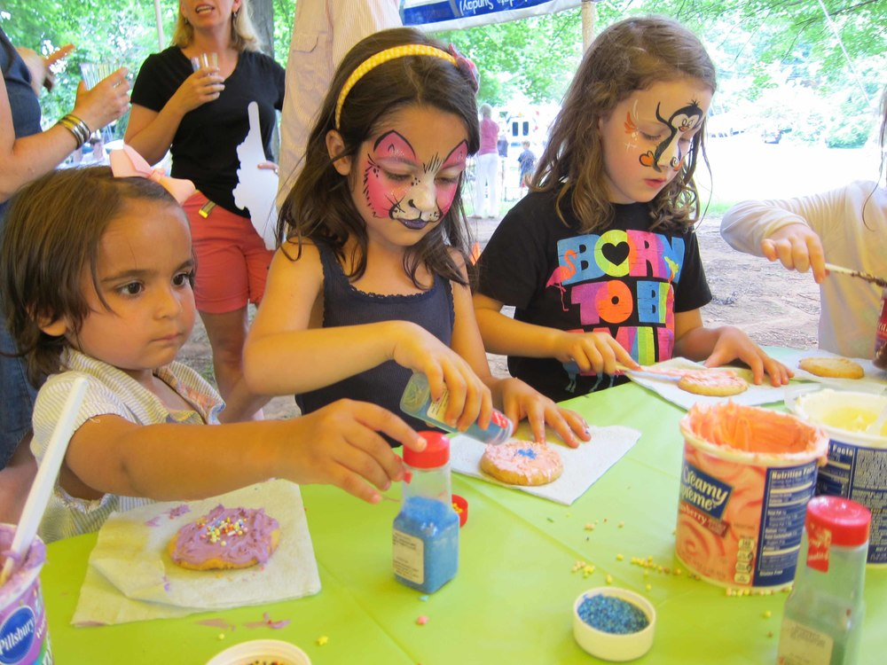 girls try their hand at gu's cookie decorating table After a stint with face painter trishla maru.