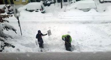 Georgetown Village volunteers dig out a member's walk.