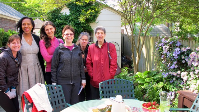 Garden club members met on a chilly May morning to enjoy hot chai and admire Carol Baume's charming garden filled with exotic plants.