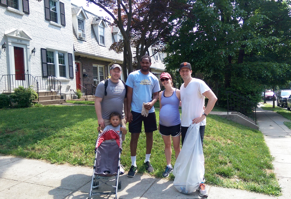 Cory Peterson, Director, GU Office of Neighborhood Life (ONL), and Riley; Theon O'Connor, community director/Burleith, ONL; and Elizabeth and Daniel.