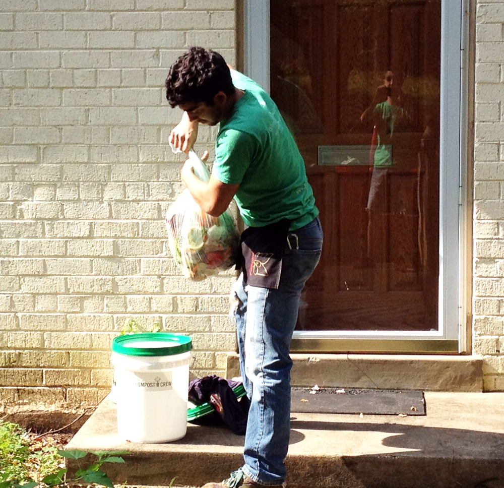 Compost Crew co-founder Brian Flores performs the rounds on a lovely spring morning, collecting compost, cleaning the bin, and bringing smiles to Compost Crew customers.