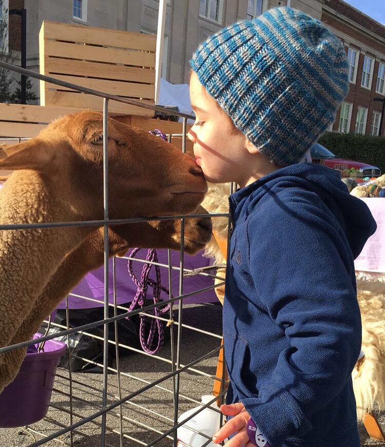 A farewell kiss at Fiber Arts Festival's mini petting zoo!