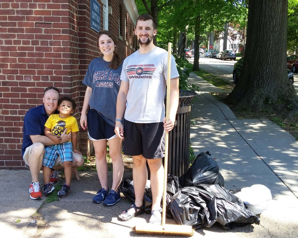 Cory Peterson (far left), director of GU's Office of Neighborhood life, and ONL program director Cat Finnegan (2nd from right) are joined by cory's son and an out-of-town volunteer.