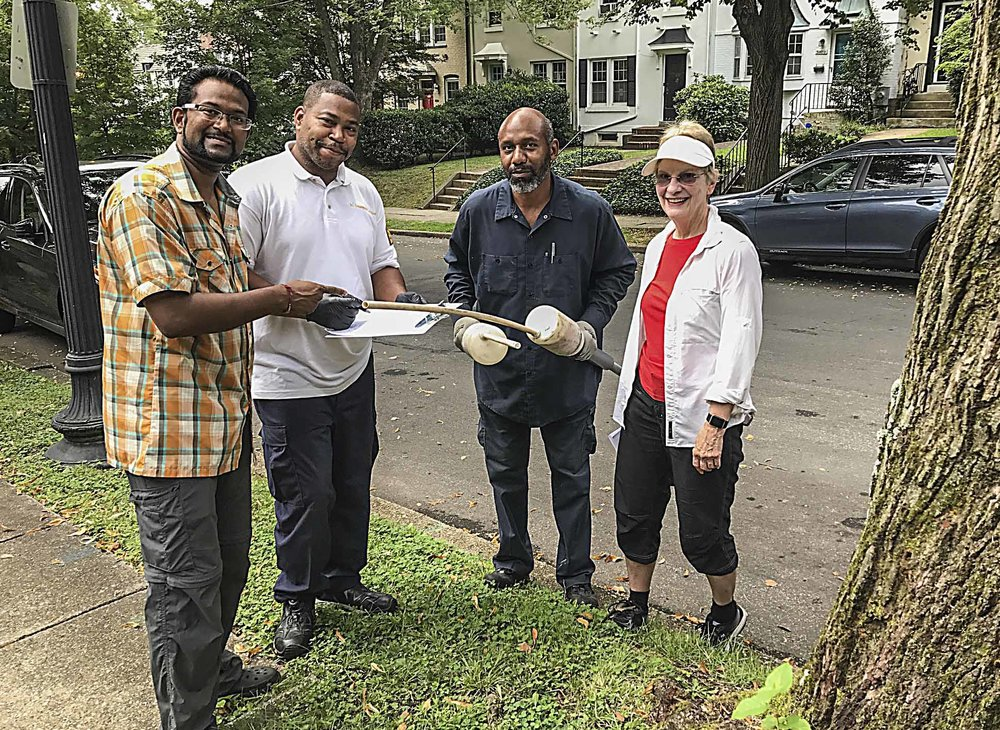 Kishan Putta and Linda Brooks flank two of the four city workers who inspected Burleith properties on August 18. Photos by Ross Schipper.
