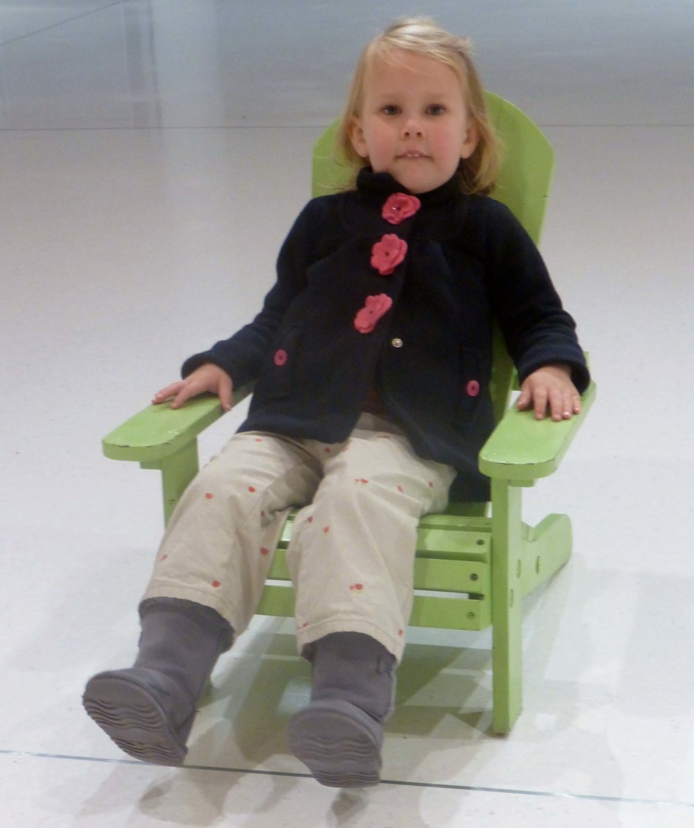 A young resident tries out a mini version of Ellington's iconic adirondack chair.