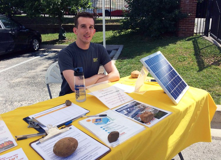 Co-op organizer Greg Miller shared info about the Georgetown-Burleith solar co-op at the farmers market last  summer.