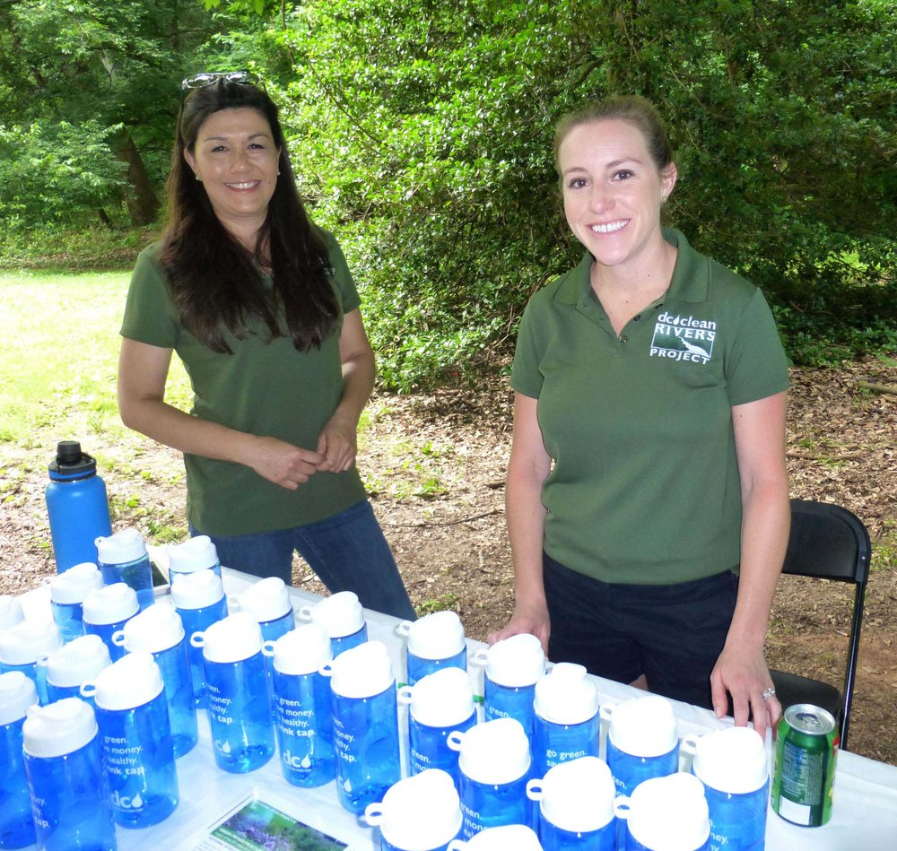 Outreach staff from DC Clean Rivers Project distributed water bottles and answered questions about permeable alley paving.