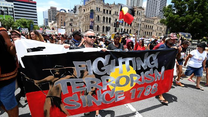 "Indigenous protesters march through central Brisbane to protest the anniversary of dispossession on ""Australia Day"" in  Brisbane, Thursday, Jan. 26, 2017. (AAP)"