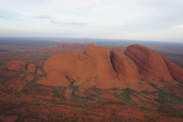 Kata Tjuta from the air -- many heads. Road in foreground give a sense of scale. Pic © author 2017