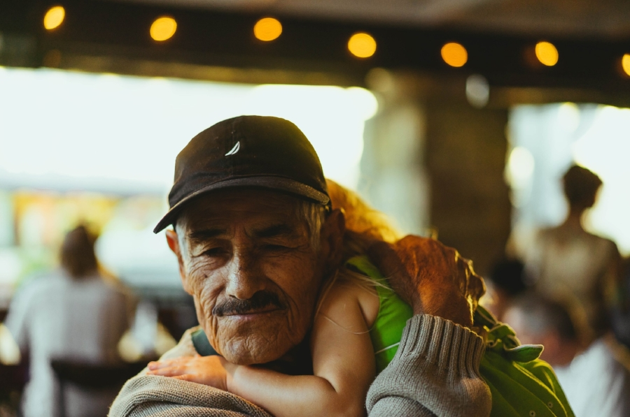 All about the hugs. Photographer's grandfather and niece by  OC Gonzalez.