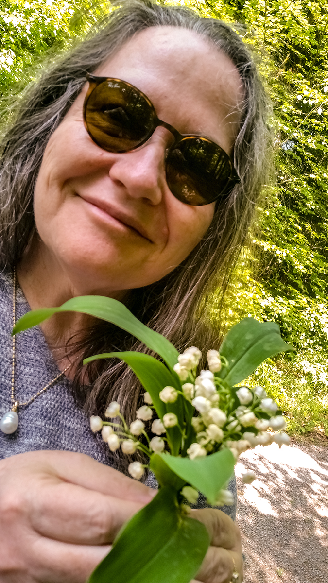 Author with lily of the valley in the Black Forest. Photo by Claudia Jocher.