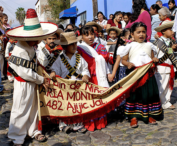 Children marching on Revolution Day in Mexico. Photo by  Ute Hagan .