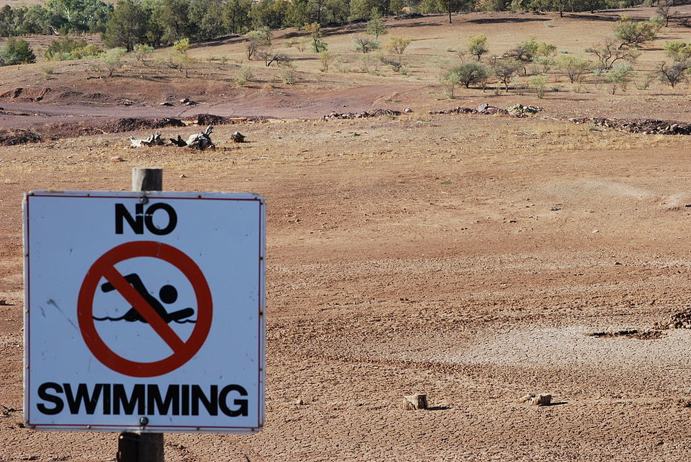 Former waterhole in drought-stricken Australia. Photo by  Peripitus  2018.