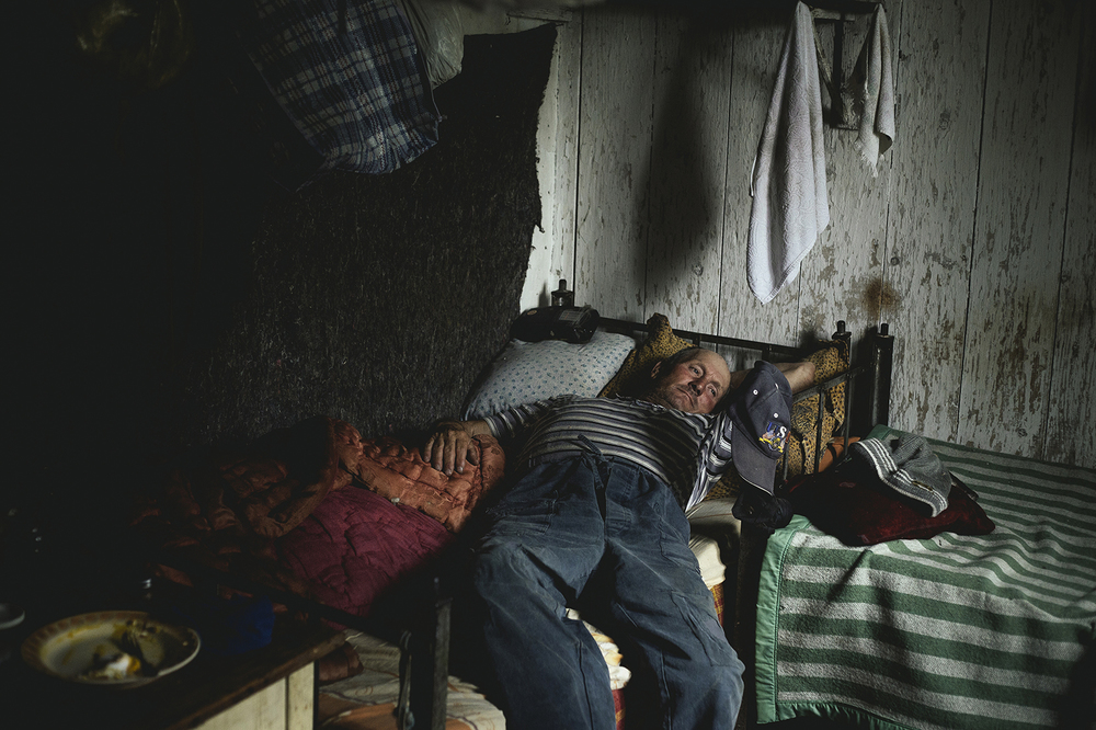 Mihail, resting at his shelter, near Sulina, Romania, 2015
