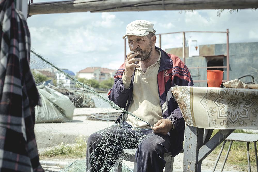 Mending nets, near the fish factory, Sulina, Romania, 2015