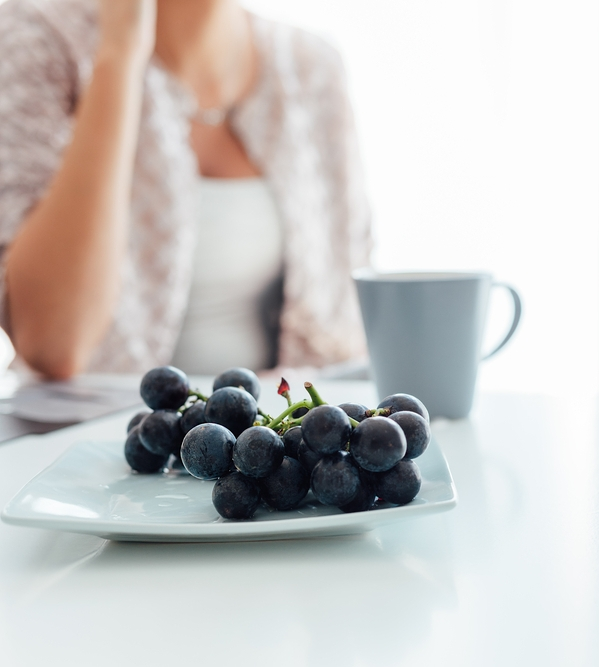 Woman with grapes.jpg
