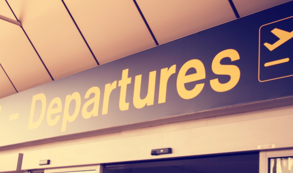 Manchester_Airport_Departure_Sign.jpg