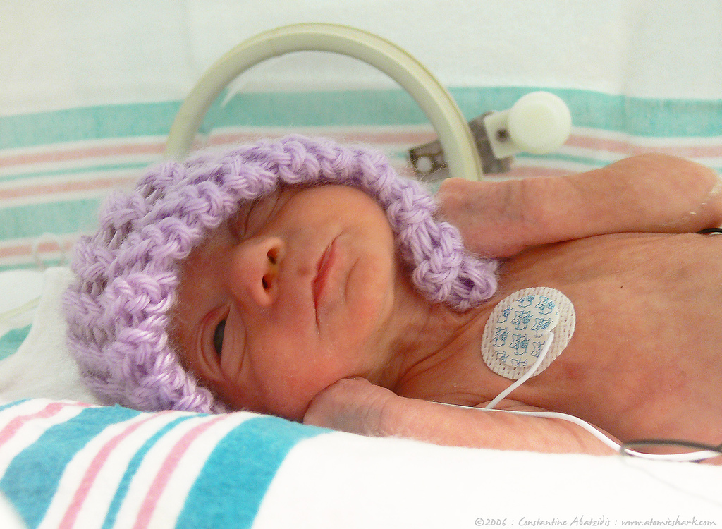 baby with purple hat