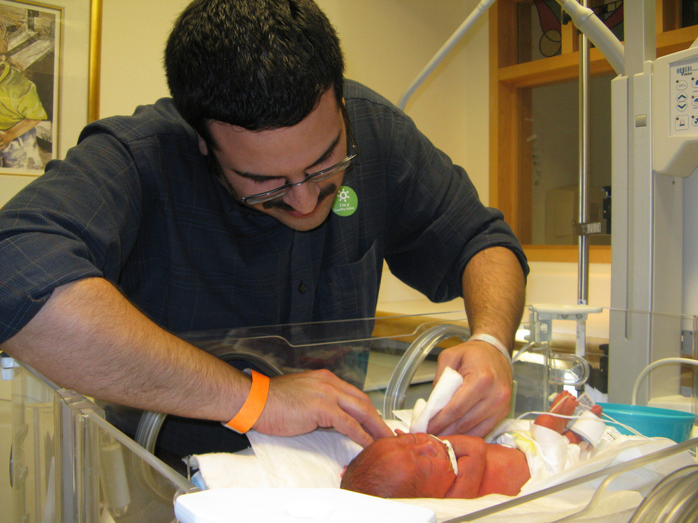 NICU dad giving his preemie a bath
