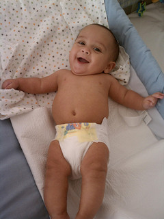 former preemie smiling in diaper