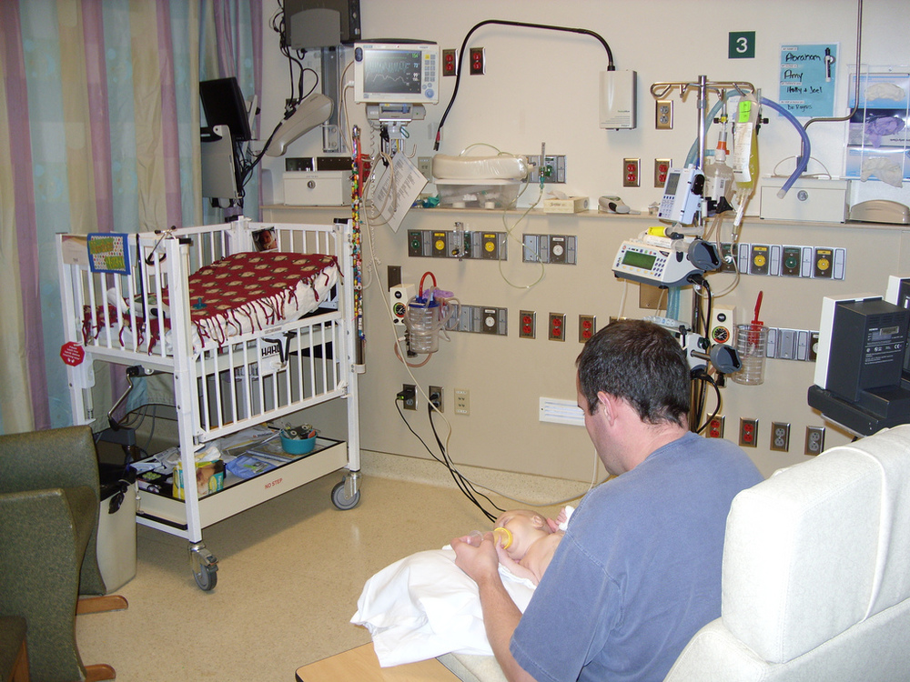 preemie in NICU with dad feeding a bottle