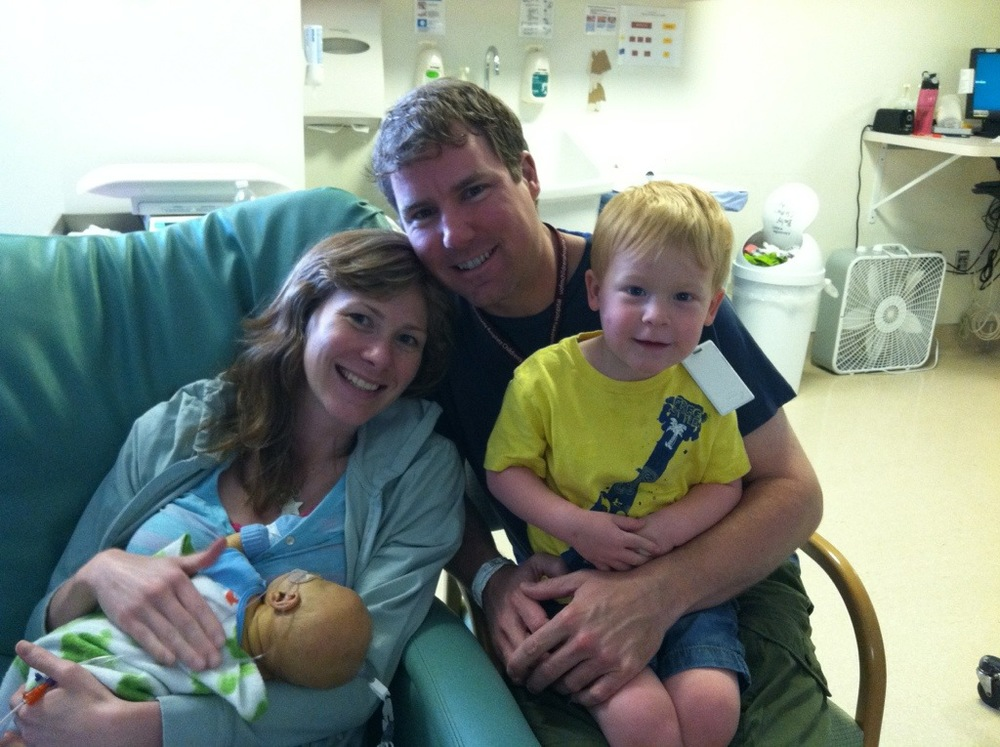 NICU family holding baby