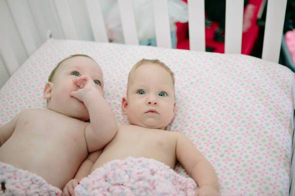 preemie twins in their crib