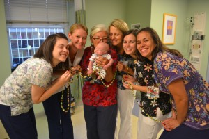 Preemie baby with NICU nurses