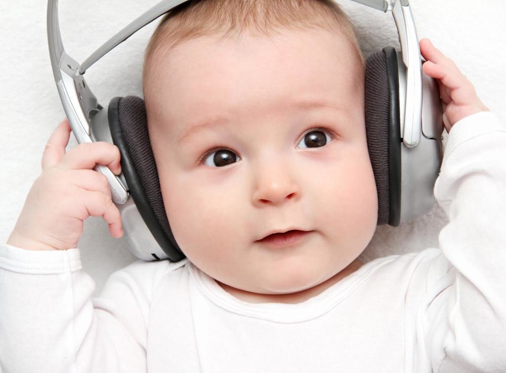 NICU baby with headphones on for music